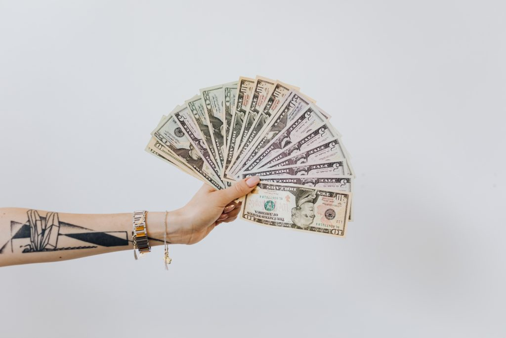 This picture shows someone holding lots of money.