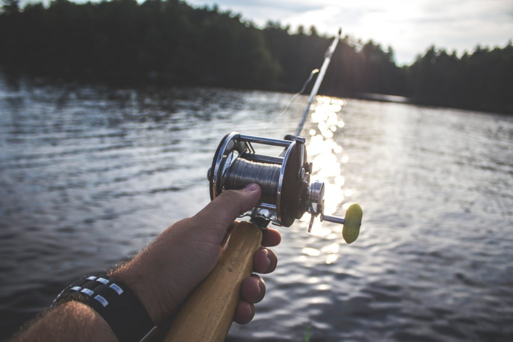 this image depicts someone fishing which requires good physical manipulation to make the most out of it