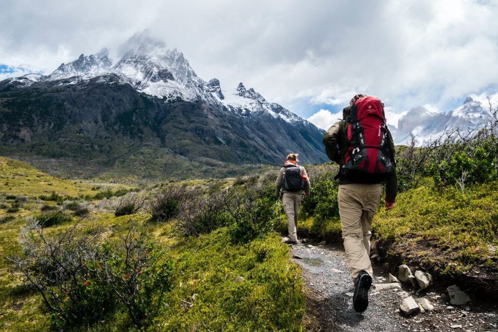 this picture shows an example of two people hiking to get closer to nature and animals